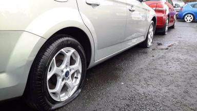 Vandals: Cars had tyres burst at a car dealership in Dundee.