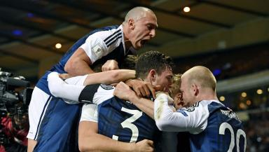 Scott Brown and his Scotland team mates celebrate the winner against Slovenia.