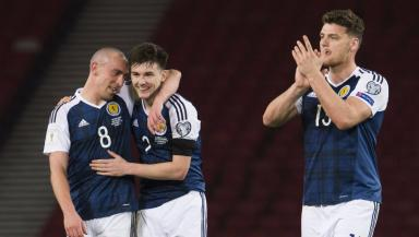 (L-R) Scott Brown, Kieran Tierney and Chris Martin celebrate at full time.
