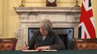 Article 50: The Prime Minister signs the letter triggering Brexit in March 2017.