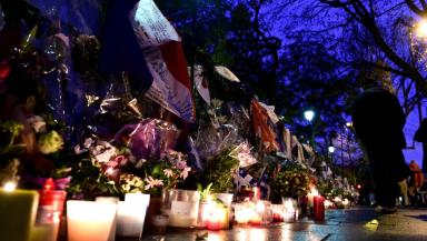 Tributes: Memorial in Paris for victims of the attack.