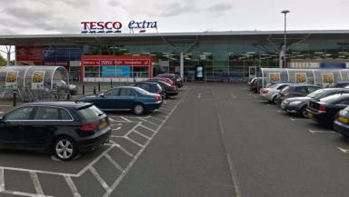 Tesco: Teenager reported over disorder outside shop.