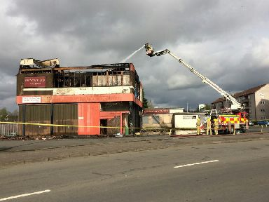 Barmulloch: Firefighters still tackling it on Monday.
