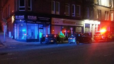Shop: Police at the scene of the incident.