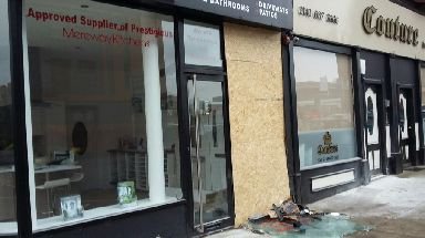 Car: Impact damaged the shopfront.