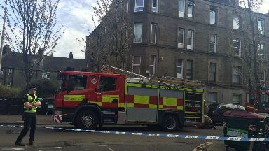 Park Avenue: Road closed after fire rips through block of flats.