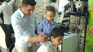 Recep with his father at the barbershop