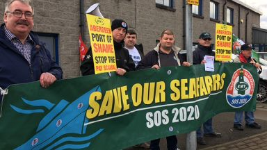 Protest: Cargo ship crew 'paid £2.56 an hour'.