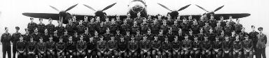 The 617 Squadron pictured in front of a Lancaster bomber.
