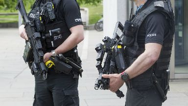 Armed police: Raided on house in Duddingston.