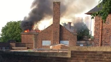 Blaze: Fire service say derelict building 'well-alight'.