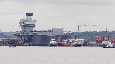 Rosyth: The warship edges her way out of dock.