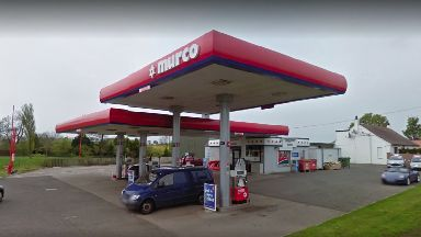 Petrol station: Staff threatened with weapons by robbers.