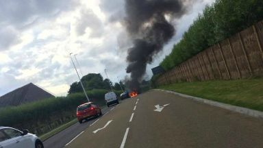 Blaze: Road was closed off while debris and fuel was cleared off.