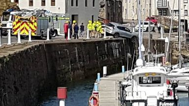 Banff harbour: Concerned onlookers watched on following the crash.