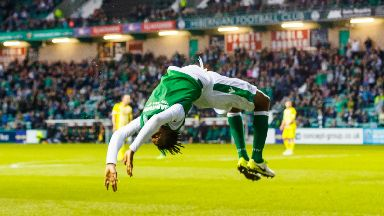 Back-flip: Efe Ambrose celebrates goal for Hibs.