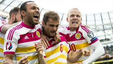 Goal hero: Maloney equalises for Scotland in a 1-1 draw in Dublin.