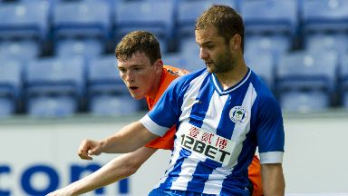 Latics: Shaun Maloney holds off Dundee United's Andy Robertson in a pre-season friendly for Wigan.