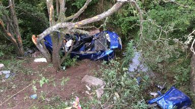 Crash: Car went down embankment bear river.