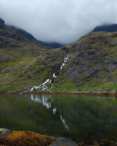 The waterfall runs into Loch Scavaig on Skye.