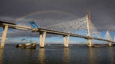 A rainbow over the crossing during its construction.