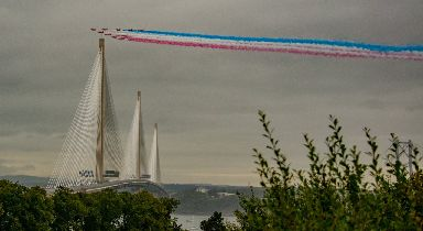 Plumes of red, white and blue smoke over the new Forth bridge.