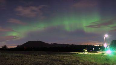 Edinburgh: Aurora shines over Arthur's Seat.