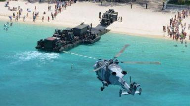 A Royal Navy Wildcat helicopter hovers arrives at the British island of Anguilla