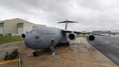 A Royal Air Force C-17 Globemaster III aircraft at Brize Norton, Oxfordshire, waiting to be loaded up with supplies