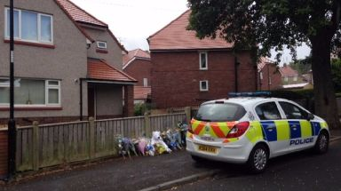 Tributes were left outside the Sunderland home following the attack.