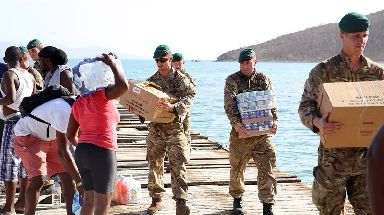 Royal Marines deliver aid and provide support to the islanders of Jost Van Dkye, British Virgin Islands.