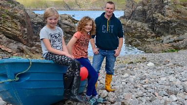 Rescued: Eve Watson and Fearn Hayley with Jamie Magee.