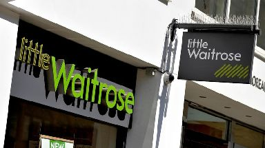 The company operates 353 Waitrose shops across the UK.