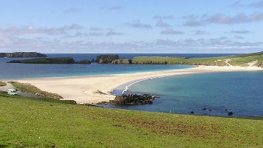 Tombolo: Strip of beach connects St Ninian's Isle to Shetland.