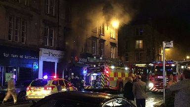 Piece: Firefighters at scene of blaze.