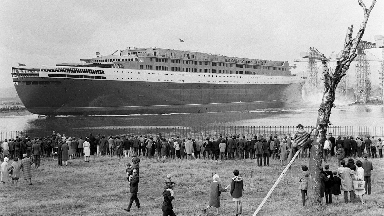 QE2: Vessel greeted by crowds at its launch from the Clyde in 1967.