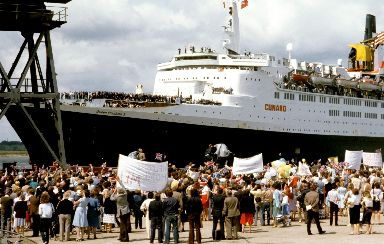 Falklands: QE2 returns from conflict with Navy survivors.