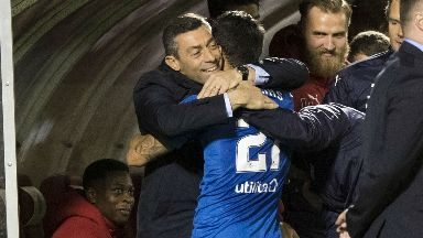 Celebration: Rangers winger Daniel Candeias hugs his manager Pedro Caixinha after making it 3-1.