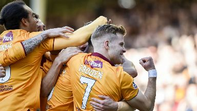 Motherwell's Chris Cadden celebrates as Peter Hartley scores from Louis Moult's free-kick