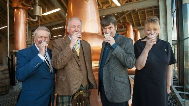 Tasting: Custodian Drew McKenzie Smith (centre, left) and Ian Rankin (centre, right).