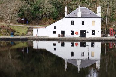 Reflections on still water on the Crinan Canal.