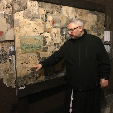 The Franciscan priests, who met Marian, guide visitors through the exhibit.