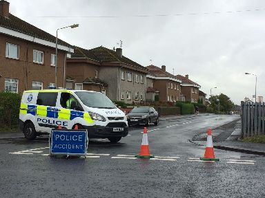Police: Quarrywood Road was sealed off after the murder on Sunday.