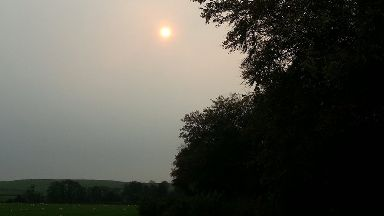 Red sun: Unusual phenomenon caught on camera in Scotland.