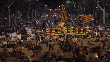 Demonstrators staged a candlelight vigil in Barcelona.