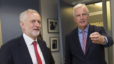 Mr Corbyn, pictured here with chief Brexit negotiator Michel Barnier in July, has arrived in Brussels.