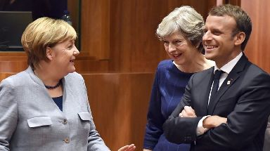 Mrs May spoke jovially with Angela Merkel and Emmanuel Macron.