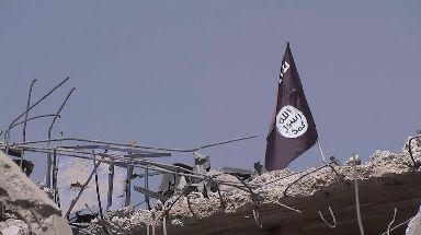 An IS flag a symbol of the brutal regime suffered by a battered city.