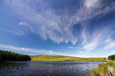 Clear blue skies overlooking Whiteadder Reservoir in East Lothian.