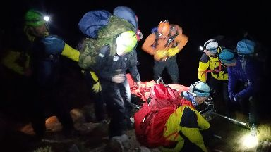 Storm: Rescuers battled their way over summit of Cairn Gorm.